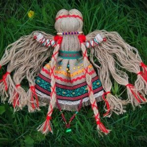 Doll souvenir from threads in the folk style